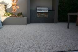 Outdoor area with aggregate concrete