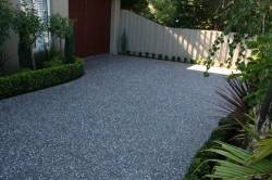 Box hedges, cream fence and aggregate concrete driveway