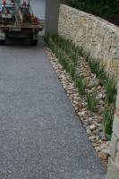 Gorgeous Aggregate mix with large pebbles and stone fence