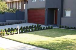 Great modern front yard using aggregate concrete